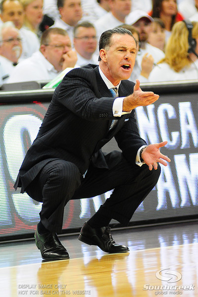 Pittsburg Panthers head coach Jamie Dixon reacts after a call on the court.   (16) Louisville Cardinals leads (4) Pittsburgh Panthers in the first half at the KFC Yum Center in Louisville, Kentucky.