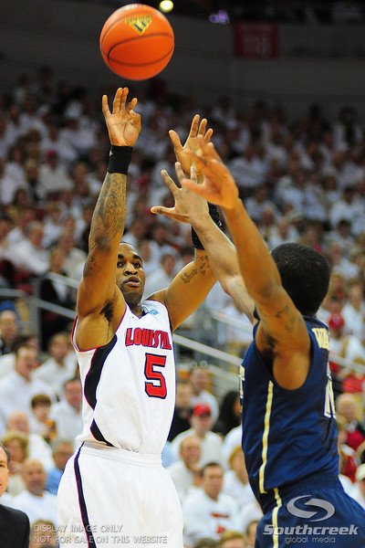 Louisville Cardinals guard Chris Smith (5) shoots a three.  (16) Louisville Cardinals lead  (4) Pittsburgh Panthers in the first half at the KFC Yum Center in Louisville, Kentucky.