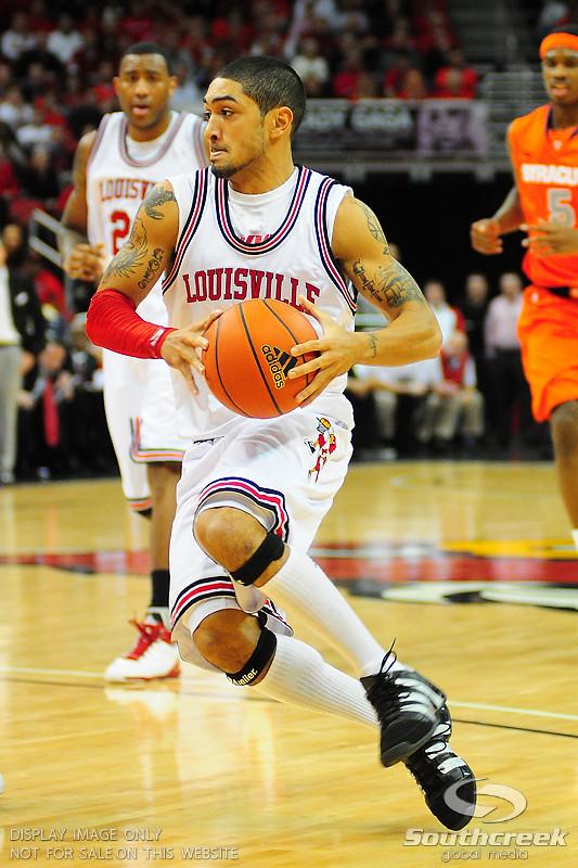 Louisville Cardinals guard Peyton Siva (3) drives to the basket.  (16) Louisville Cardinals defeated  the (12) Syracuse Orangemen 73-69 at the KFC Yum Center in Louisville, Kentucky.