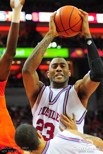 Louisville Cardinals forward Terrence Jennings (23) comes down strong for a rebond.  (16) Louisville Cardinals defeated  the (12) Syracuse Orangemen 73-69 at the KFC Yum Center in Louisville, Kentucky.