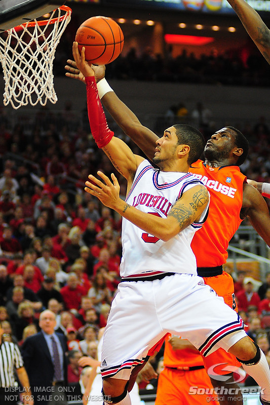 Louisville Cardinals guard Peyton Siva (3) goes up strong for two.  (16) Louisville Cardinals defeated  the (12) Syracuse Orangemen 73-69 at the KFC Yum Center in Louisville, Kentucky.