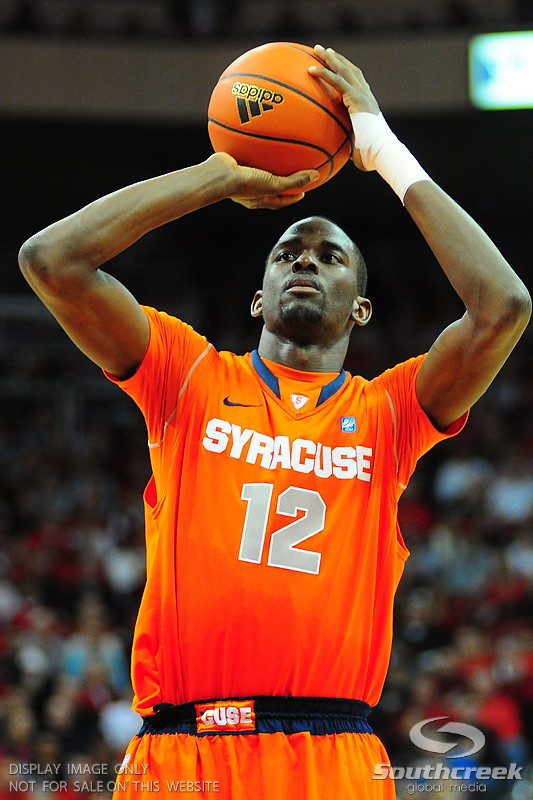 Syracuse Orange forward Baye Moussa Keita (12) shoots a free throw.  (16) Louisville Cardinals defeated  the (12) Syracuse Orangemen 73-69 at the KFC Yum Center in Louisville, Kentucky.