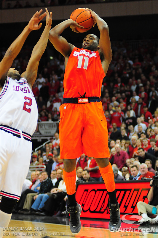 Syracuse Orange guard Scoop Jardine (11) shoots a jump shot.  (16) Louisville Cardinals defeated  the (12) Syracuse Orangemen 73-69 at the KFC Yum Center in Louisville, Kentucky.
