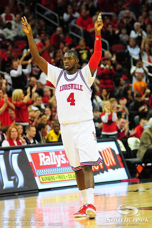 Louisville Cardinals forward Rakeem Buckles (4) calls a play.  (16) Louisville Cardinals defeated  the (12) Syracuse Orangemen 73-69 at the KFC Yum Center in Louisville, Kentucky.