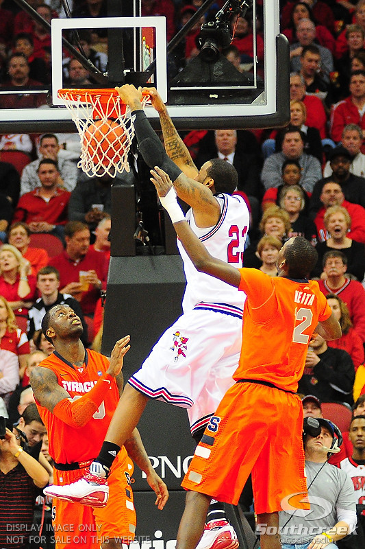 Louisville Cardinals forward Terrence Jennings (23) with a slam dunk.  (16) Louisville Cardinals defeated  the (12) Syracuse Orangemen 73-69 at the KFC Yum Center in Louisville, Kentucky.