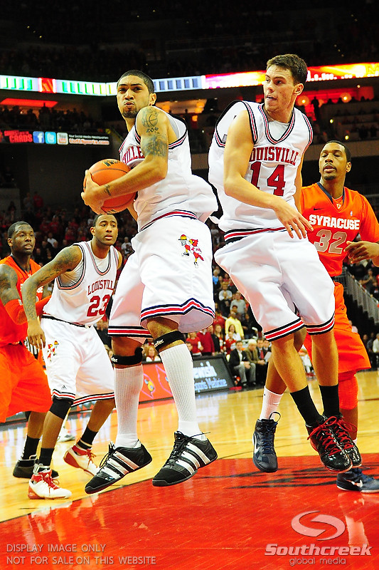 Louisville Cardinals guard Peyton Siva (3) comes down stroung with a rebound.  (16) Louisville Cardinals defeated  the (12) Syracuse Orangemen 73-69 at the KFC Yum Center in Louisville, Kentucky.