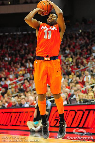 Syracuse Orange guard Scoop Jardine (11) shoots one of his four three's.  (16) Louisville Cardinals defeated  the (12) Syracuse Orangemen 73-69 at the KFC Yum Center in Louisville, Kentucky.