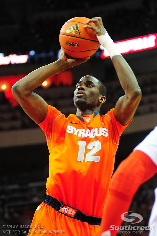 Syracuse Orange forward Baye Moussa Keita (12) shoots a jump shot.  (16) Louisville Cardinals defeated  the (12) Syracuse Orangemen 73-69 at the KFC Yum Center in Louisville, Kentucky.
