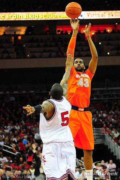 Syracuse Orange forward James Southerland (43) with a jump shot over Louisville Cardinals guard Chris Smith (5).  (16) Louisville Cardinals defeated  the (12) Syracuse Orangemen 73-69 at the KFC Yum Center in Louisville, Kentucky.
