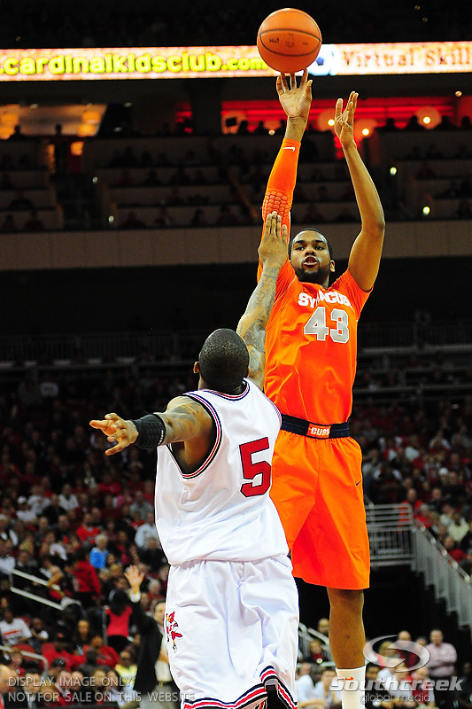 Syracuse Orange forward James Southerland (43) with a jump shot over Louisville Cardinals guard Chris Smith (5).  (16) Louisville Cardinals defeated  the (12) Syracuse Orangemen 73-69 at the KFC Yum Center in Louisville, Kentucky.