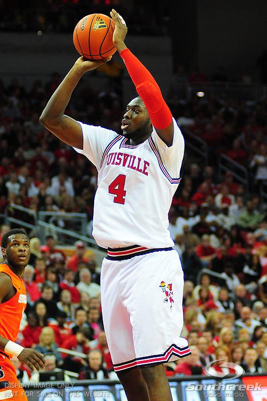 Louisville Cardinals forward Rakeem Buckles (4) shoots a jump shot.  (16) Louisville Cardinals defeated  the (12) Syracuse Orangemen 73-69 at the KFC Yum Center in Louisville, Kentucky.