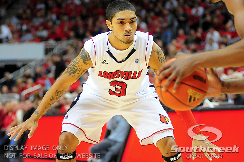 Louisville Cardinals guard Peyton Siva (3) on defence.  Louisville Cardinals defeated UNLV Rebels 77 - 69 at the KFC Yum Center in Louisville, Kentucky.