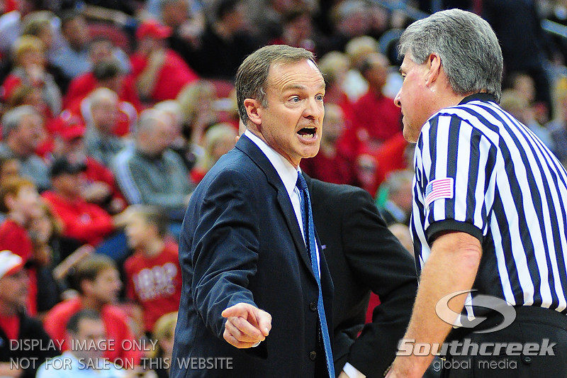 UNLV Rebels head coach Lon Kruger argues a call with an official.  UNLV Rebels lead Louisville Cardinals 38 - 33 at the half at the KFC Yum Center in Louisville, Kentucky.