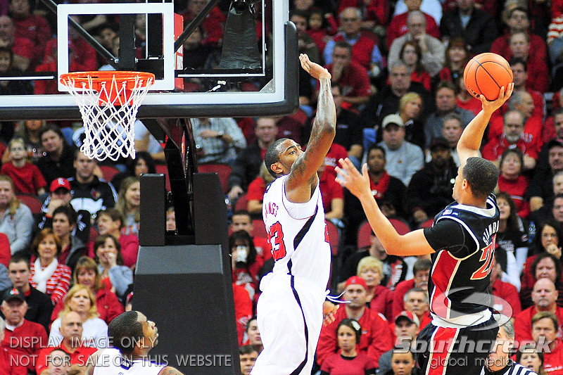 UNLV Rebels guard/forward Chace Stanback (22) shoots the ball over Louisville Cardinals forward Terrence Jennings (23).  Louisville Cardinals defeated UNLV Rebels 77 - 69 at the KFC Yum Center in Louisville, Kentucky.