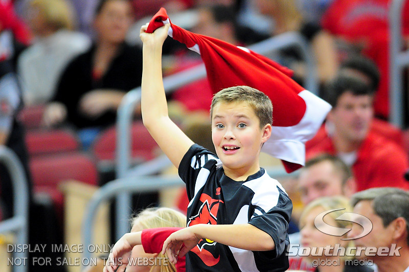 Young Louisville Cardinals fan cheers during the game.  Louisville Cardinals defeated UNLV Rebels 77 - 69 at the KFC Yum Center in Louisville, Kentucky.