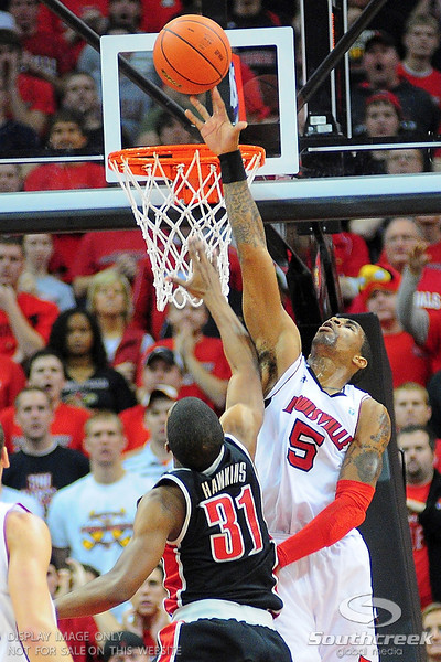 Louisville Cardinals guard Chris Smith (5) blocks UNLV Rebels guard Justin Hawkins (31).  Louisville Cardinals defeated UNLV Rebels 77 - 69 at the KFC Yum Center in Louisville, Kentucky.