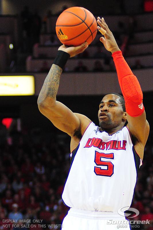 Louisville Cardinals guard Chris Smith (5) shoots the ball.  Louisville Cardinals defeated UNLV Rebels 77 - 69 at the KFC Yum Center in Louisville, Kentucky.