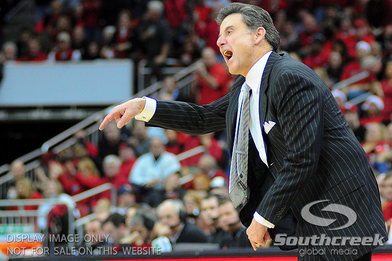 Louisville Cardinals head coach Rick Pitino yelling at his players.  Louisville Cardinals defeated UNLV Rebels 77 - 69 at the KFC Yum Center in Louisville, Kentucky.