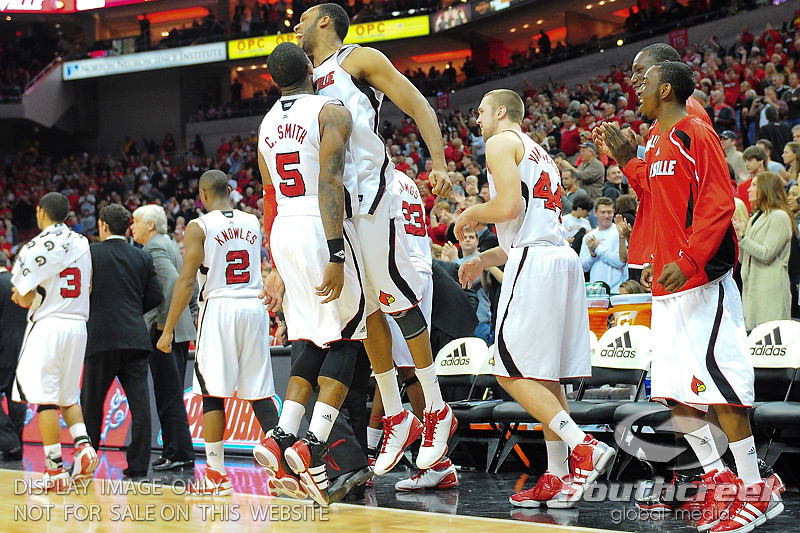 Louisville Cardinals forward George Goode (0) and Louisville Cardinals guard Chris Smith (5) celebrate the win.  Louisville Cardinals defeated UNLV Rebels 77 - 69 at the KFC Yum Center in Louisville, Kentucky.