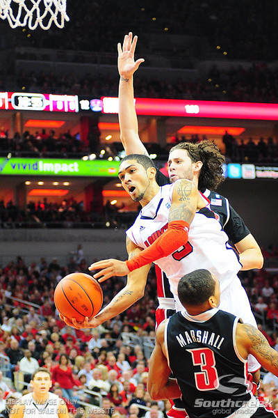 Louisville Cardinals guard Peyton Siva (3) goes up strong over UNLV Rebels guard Anthony Marshall (3).  Louisville Cardinals defeated UNLV Rebels 77 - 69 at the KFC Yum Center in Louisville, Kentucky.