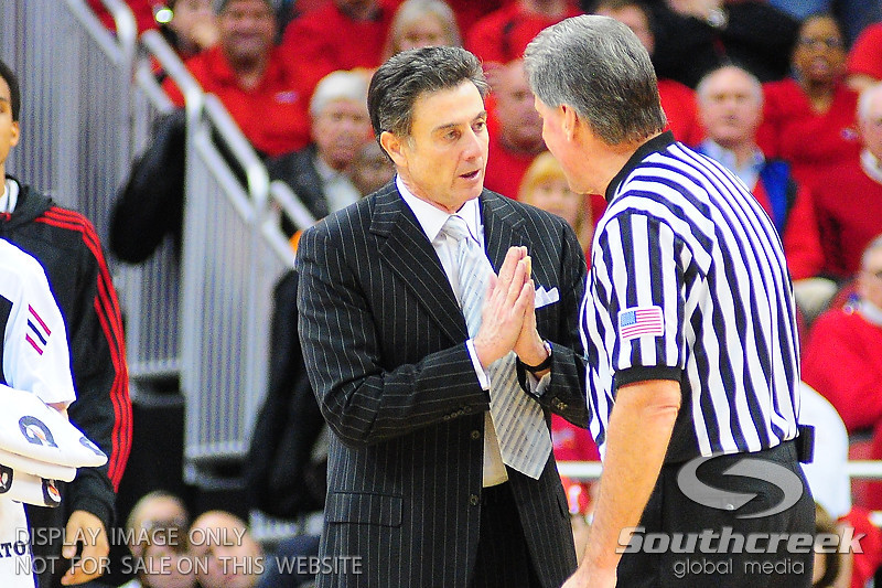 Louisville Cardinals head Rick Pitino coach pleads his case with an official.  UNLV Rebels lead Louisville Cardinals 38 - 33 at the half at the KFC Yum Center in Louisville, Kentucky.