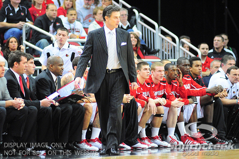Louisville Cardinals head coach Rick Pitino paces on the sidelines.  Louisville Cardinals defeated UNLV Rebels 77 - 69 at the KFC Yum Center in Louisville, Kentucky.