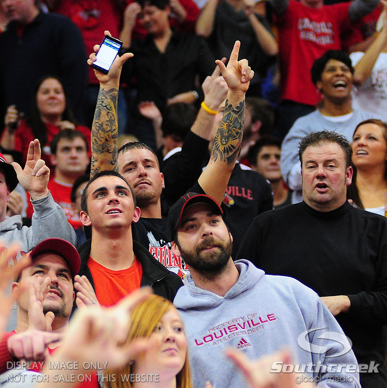 Louisville Cardinals fans.  Louisville Cardinals defeated West Virginia Mountaineers 55-54  at the KFC Yum Center in Louisville, Kentucky.