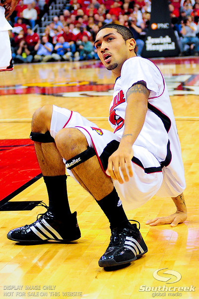 Louisville Cardinals guard Peyton Siva (3) wondering why he was called for a foul at the KFC Yum Center in Louisville, Kentucky.