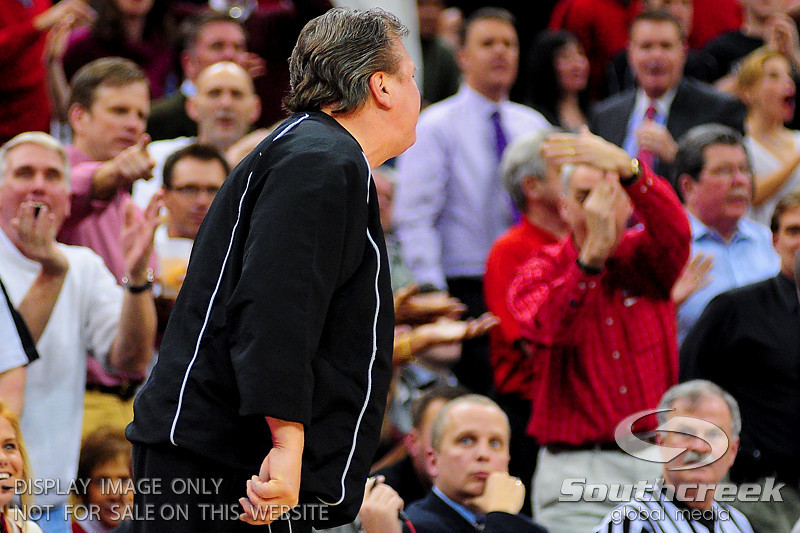 Louisville Cardinals fans in the background as West Virginia Mountaineers head coach Bob Huggins gets a technical foul.  Louisville Cardinals defeated West Virginia Mountaineers 55-54  at the KFC Yum Center in Louisville, Kentucky.