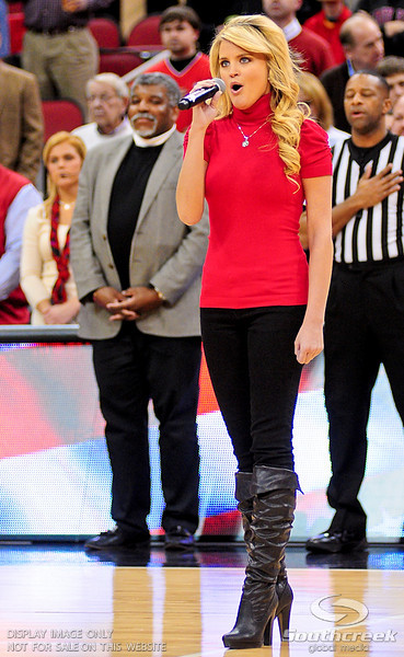 Country singing star Olivia Henken sings the National Anthem before the game at the KFC Yum Center in Louisville, Kentucky.