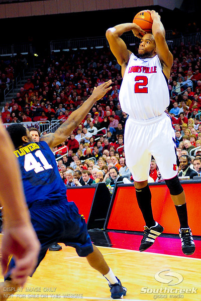 Louisville Cardinals guard Preston Knowles (2) shoots the ball over West Virginia Mountaineers forward John Flowers (41) at the KFC Yum Center in Louisville, Kentucky.