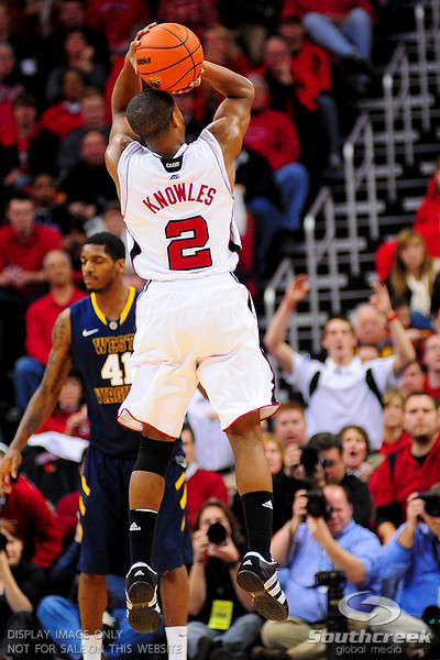 Louisville Cardinals guard Preston Knowles (2) shoots a three in the second half.  Louisville Cardinals defeated West Virginia Mountaineers 55-54  at the KFC Yum Center in Louisville, Kentucky.