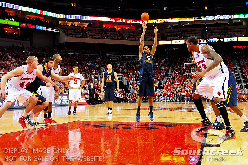 West Virginia Mountaineers forward Kevin Jones (5) shoots a free throw.  Louisville Cardinals defeated West Virginia Mountaineers 55-54  at the KFC Yum Center in Louisville, Kentucky.