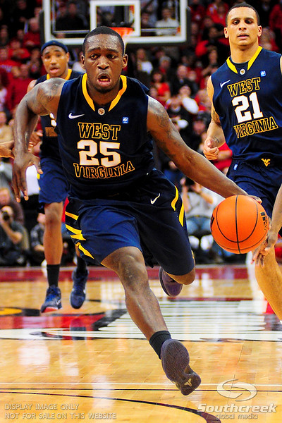 West Virginia Mountaineers guard Darryl Bryant (25) drives the lane.  Louisville Cardinals defeated West Virginia Mountaineers 55-54  at the KFC Yum Center in Louisville, Kentucky.