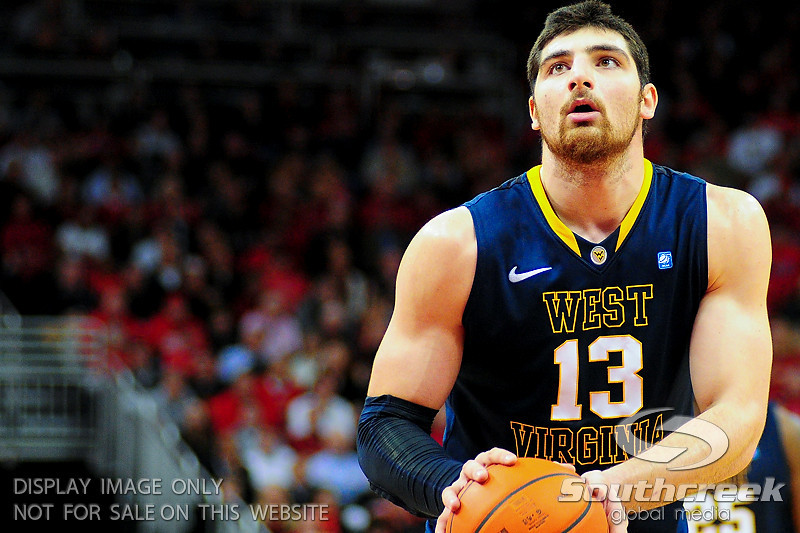 West Virginia Mountaineers forward Deniz Kilicli (13) shoots a free throw.  Louisville Cardinals defeated West Virginia Mountaineers 55-54  at the KFC Yum Center in Louisville, Kentucky.