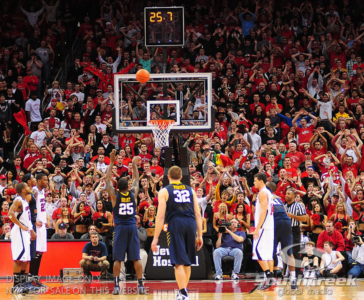 West Virginia Mountaineers guard Darryl Bryant (25) missed two free throw with twenty five point seven seconds on the clock.  Louisville Cardinals defeated West Virginia Mountaineers 55-54  at the KFC Yum Center in Louisville, Kentucky.