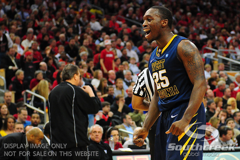 West Virginia Mountaineers guard Darryl Bryant (25) pumps after a great defensive play in the first half at the KFC Yum Center in Louisville, Kentucky.