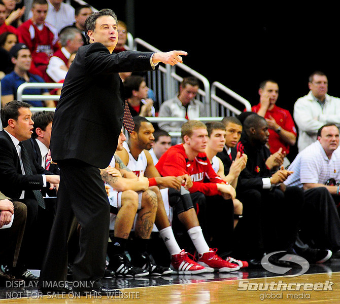 Louisville Cardinals head coach Rick Pitino yells instructions.  Louisville Cardinals defeated West Virginia Mountaineers 55-54  at the KFC Yum Center in Louisville, Kentucky.
