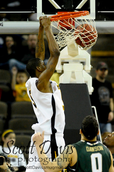 Northern Kentucky Norse forward Ernest Watson #5 with a slam during the come back down 13 with 2:36 left on the clock between Northern Kentucky Norse and  Jacksonville Dolphins . Northern Kentucky Norse defeated Jacksonville Dolphins 66-62 at The Bank of Kentucky Center in Highland Heights, Kentucky.