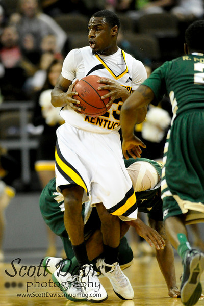 Northern Kentucky Norse guard Todd Johnson #23 grabs the loose ball during the college basketball game between Northern Kentucky Norse and  Jacksonville Dolphins . Northern Kentucky Norse defeated Jacksonville Dolphins 66-62 at The Bank of Kentucky Center in Highland Heights, Kentucky.
