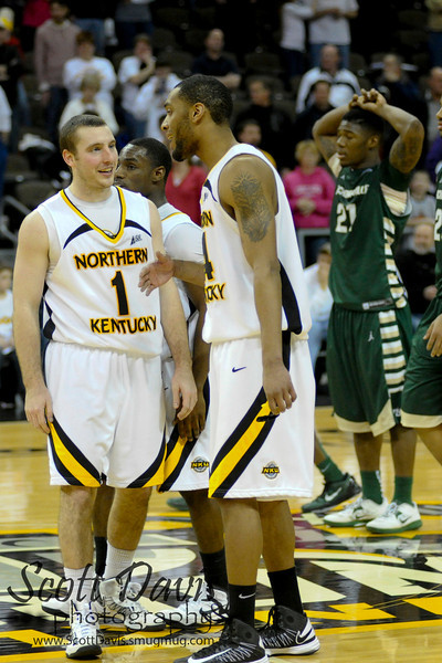 Northern Kentucky Norse guard Ethan Faulkner #1 and Northern Kentucky Norse guard Chad Jackson #24 celebrate at half court during the college basketball game between Northern Kentucky Norse and  Jacksonville Dolphins . Northern Kentucky Norse defeated Jacksonville Dolphins 66-62 at The Bank of Kentucky Center in Highland Heights, Kentucky.
