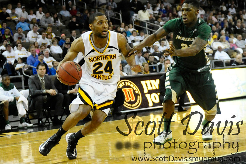 Northern Kentucky Norse guard Chad Jackson #24 drives to the basket during the college basketball game between Northern Kentucky Norse and  Jacksonville Dolphins .  Jacksonville Dolphins lead the Northern Kentucky Norse 30-29 at the half at The Bank of Kentucky Center in Highland Heights, Kentucky.