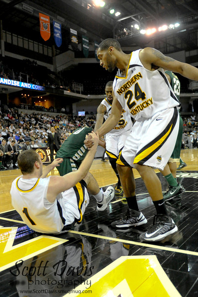 Northern Kentucky Norse guard Chad Jackson #24 helps up Northern Kentucky Norse guard Ethan Faulkner #1 after taking a charge during the college basketball game between Northern Kentucky Norse and  Jacksonville Dolphins . Northern Kentucky Norse defeated Jacksonville Dolphins 66-62 at The Bank of Kentucky Center in Highland Heights, Kentucky.