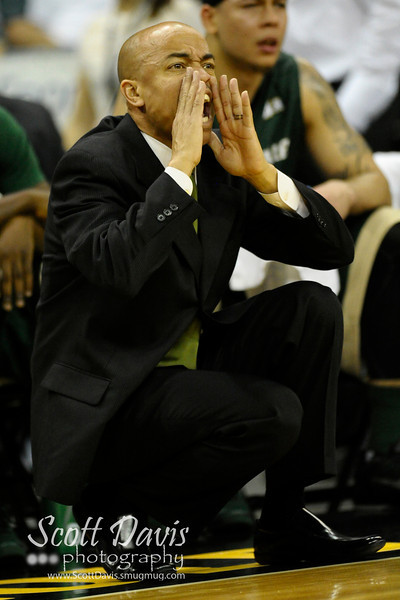Jacksonville Dolphins head coach Cliff Warren yells out instructions during the college basketball game between Northern Kentucky Norse and  Jacksonville Dolphins .  Jacksonville Dolphins lead the Northern Kentucky Norse 30-29 at the half at The Bank of Kentucky Center in Highland Heights, Kentucky.