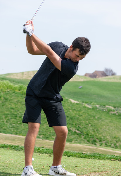 Jeremy Gandon, a senior in finance, focuses his gaze towards the ball while in his backswing during practice on April 15 at Colbert Hills golf course. The men's golf team competes in the Big 12 Championship April 26 through April 28 in White Sulphur Springs, West Virginia. (Brooke Barrett | Collegian Media Group)