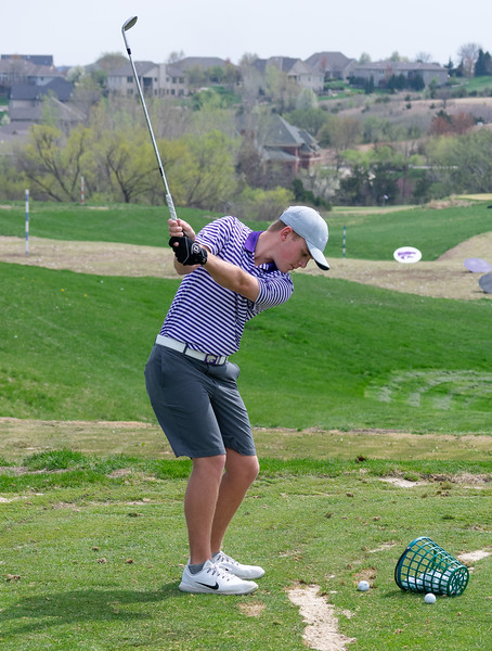 Ryan Bender, a freshman in business administration, focuses his gaze towards the ball while in his backswing during practice on April 15 at Colbert Hills golf course. The men's golf team competes in the Big 12 Championship April 26 through April 28 in White Sulphur Springs, West Virginia. (Brooke Barrett | Collegian Media Group)
