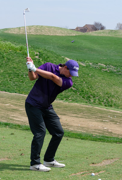 Roland Massimino, a senior in finance, focuses on his backswing on the driving range during practice on April 15 at Colbert Hills golf course. The men's golf team competes in the Big 12 Championship April 26 through April 28 in White Sulphur Springs, West Virginia. (Brooke Barrett | Collegian Media Group)