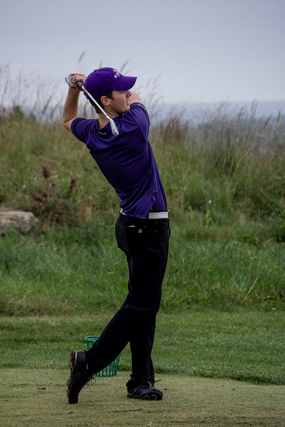 Jared Strathe, a freshman in business administration, powerfully strikes his tee shot on the driving range before playing an 18 hole practice round. This took place at 3 p.m. on Oct. 5 at Colbert Hills Country Club. (Brooke Barrett | Collegian Media Group)