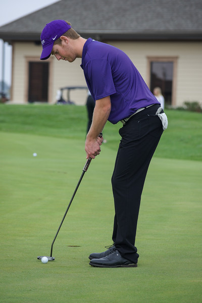 Jared Strathe, a freshman in business administration, practices his putting stroke and speed before playing an 18 hole practice round at Colbert Hills Country Club. This practice occurred at 3 p.m. on Oct. 5. (Brooke Barrett | Collegian Media Group)