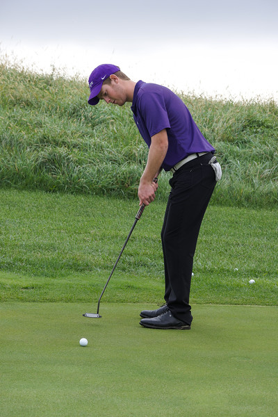 Jared Strathe, a freshman in business administration, practices his putting stroke and speed before playing 18 holes at Colbert Hills Country Club. This practice occurred at 3 p.m. on Oct. 5. (Brooke Barrett | Collegian Media Group)